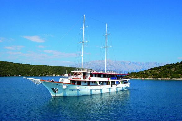 The motor yacht Harmonia, ready to take on clients for their island-to-island bike tours.