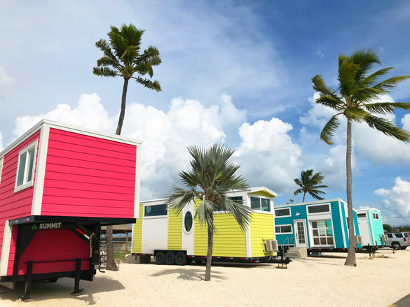 The five new tiny houses that make up Petite Retreats Sunshine Key Tiny House Village, aptly named Kai, Pearl, Lucy, Isla, and Hemingway, are each under 350 square feet in size. The colorful tiny house village resides on the shore of the 75-acre island of