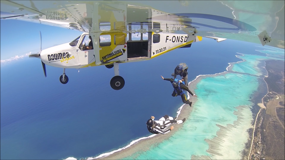 Skydiving over New Caledonia's lagoon