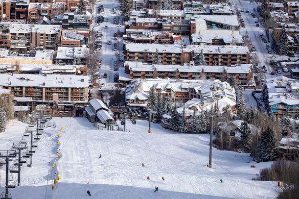 Aspen mountain early ups photo shoot with a foot new snow Morris snowboarder (red Jacket) Xan skier (orange pants) @mattpower