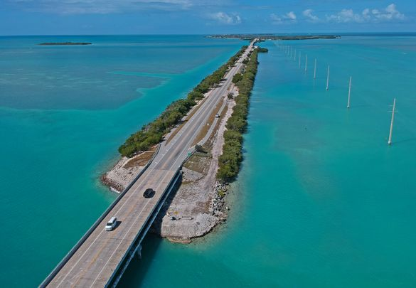 Vehicular traffic on the Florida Keys Overseas Highway is extremely light Tuesday, March 24, 2020, in Islamorada, Fla. The subtropical island destination is temporarily closed to visitors until further notice due to the coronavirus crisis, according to lo