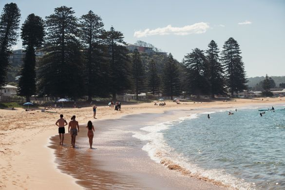 Visitors enjoying a day at Avoca Beach on the Central Coast.