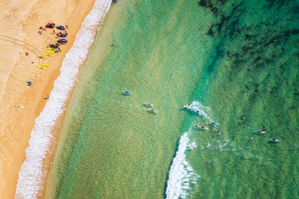 Aerial of paddleboarders at Toowoon Bay, Central Coast.