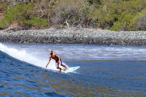 Riding the waves at Ollie's Point, Costa Rica