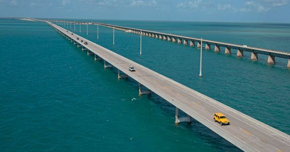 Traffic rolls on the Florida Keys Overseas Highway's Seven Mile Bridge Sunday, Oct. 1, 2017, near Marathon, Fla. Sunday marked the first day, since Hurricane Irma passed through the Florida Keys on Sept. 10, that Keys officials gave the green light for vi