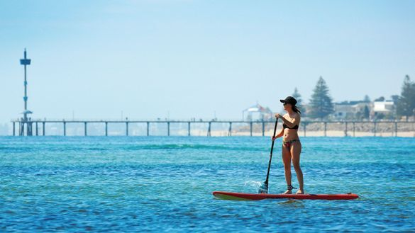 Stand-up paddleboarding at Brighton beach, which is just 10 minutes drive away from Glenelg