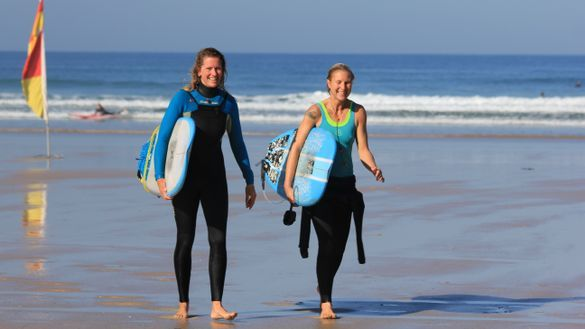 Happy mums after a surf in Cornwall